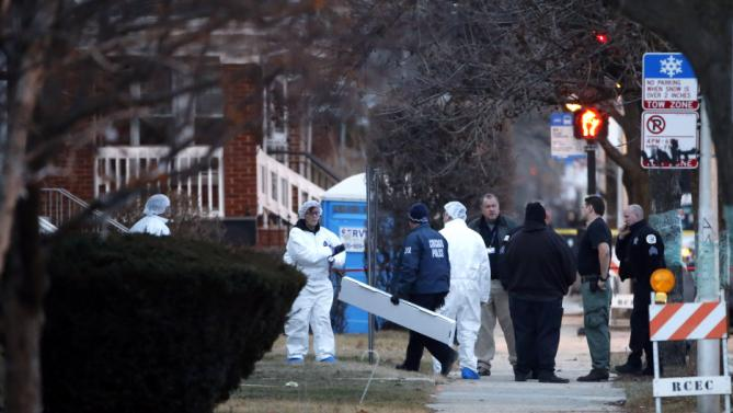 Chicago police investigators work outside a home where the bodies of six people were found after police performed a well being check Thursday, Feb. 4, 2016, in Chicago. Interim police Superintendent John Escalante told reporters the bodies of four men, one woman and a child have been found inside a home on the city's South Side in what Escalante said could be a murder-suicide. Escalante says police entered the house in Chicago's Gage Park neighborhood after receiving a call from a co-worker to check on a man who lived there. He missed two days of work, which was unusual. (AP Photo/Charles Rex Arbogast)